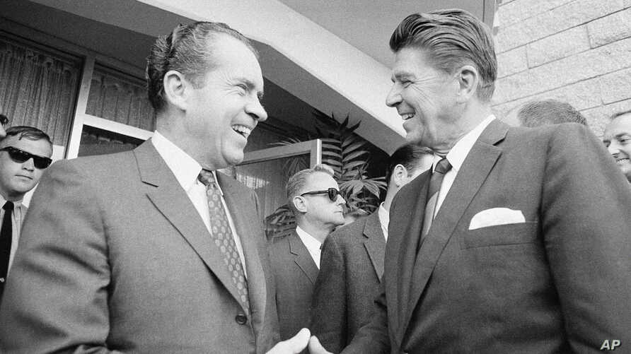 FILE - President Richard Nixon greets California Governor Ronald Reagan, right, in San Diego on Aug. 16, 1968.