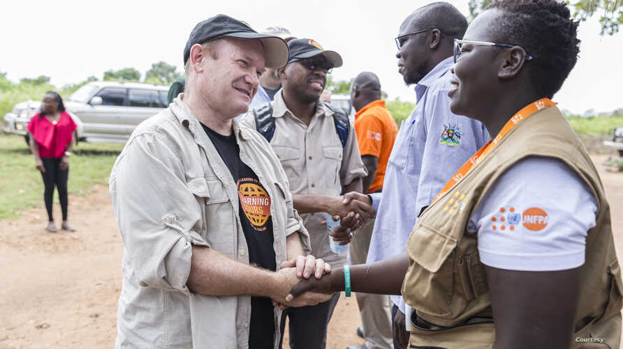 US Senator Chris Coons (D-DE) tours refugee settlement in Uganda.