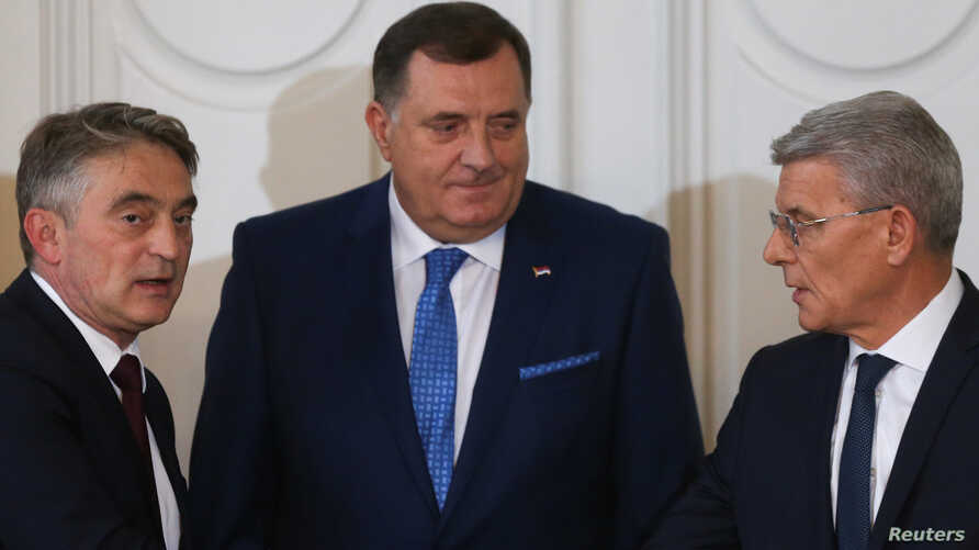 Newly elected members of Bosnia's tripartite inter-ethnic presidency, Croat member Zeljko Komsic, Serb member Milorad Dodik and Bosniak member Sefik Dzaferovic, attend the presidential inauguration ceremony in Sarajevo, Nov. 20, 2018.