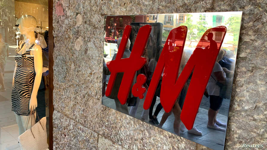 An H&M sign is seen at the entrance to an H&M store in Palma on the island of Mallorca, Spain June 14, 2019.