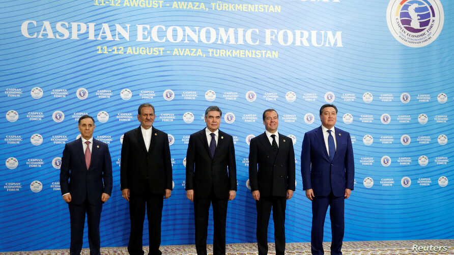 From left, Azeri Prime Minister Mammadov, Iranian Vice President Jahangiri, Turkmen President Berdimuhamedov, Russian Prime Minister Medvedev and Kazakh Prime Minister Mamin pose for a photo during the First Caspian Economic Forum in Turkmenbashi.