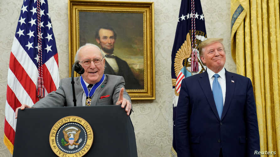 U.S. President Donald Trump smiles after presenting the Presidential Medal of Freedom to Boston Celtics legend and Basketball Hall of Famer Bob Cousy in the Oval Office of the White House, Aug. 22, 2019.