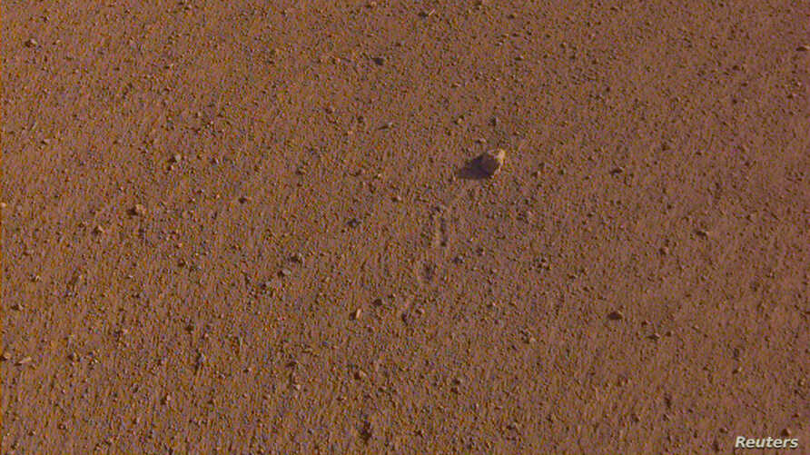 "The ""Rolling Stones Rock,"" slightly larger than a golf ball and named after the rock band, is seen on the surface of Mars after it rolled about 3 feet, spurred by the thrusters on NASA's InSight spacecraft, Nov. 26, 2018."
