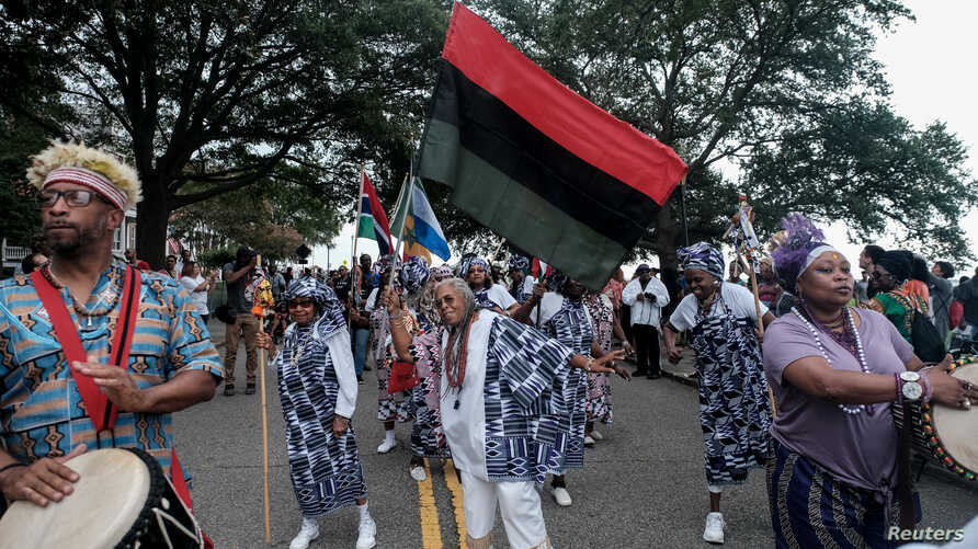 African dancers take part in the American Evolution 2019 Commemoration ceremony, marking the 400-year anniversary of the arrival