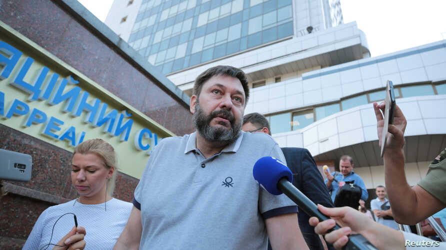 Kirill Vyshinsky, director of the Ukrainian office of the Russian state news agency RIA Novosti, who was detained on treason charges in 2018, talks to the media after a court ordered his release on bail, in Kyiv, Ukraine, Aug. 28, 2019.