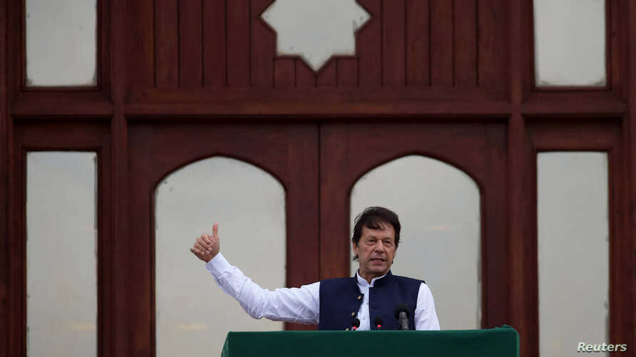 Pakistan's Prime Minister Imran Khan gestures as he speaks during a countrywide 'Kashmir Hour' demonstration to express solidarity with the people of Kashmir, at the Prime Minister's House in Islamabad, Pakistan, Aug. 30, 2019.