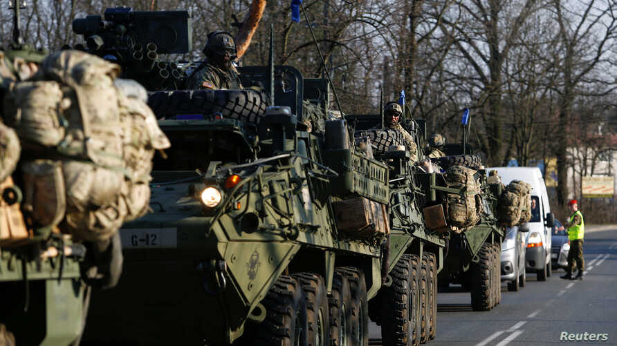 FILE - A convoy of U.S. troops, a part of NATO's reinforcement of its eastern flank, drive from Germany to Orzysz in northeast Poland, March 28, 2017.