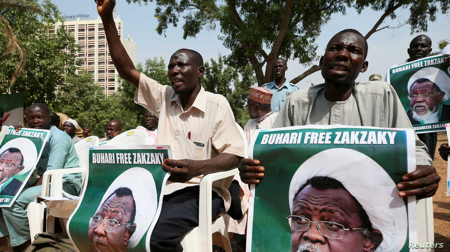 Protesters hold banners calling for the release of Sheikh Ibrahim Zakzaky, the leader of the Islamic Movement of Nigeria , in Abuja, Nigeria Jan. 26, 2018.