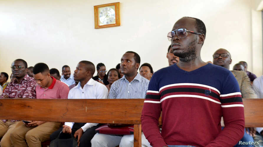 Tanzanian investigative journalist Erick Kabendera sits inside the Kisutu Residents Magistrate Court in Dar es Salaam, Tanzania, Aug. 5, 2019.