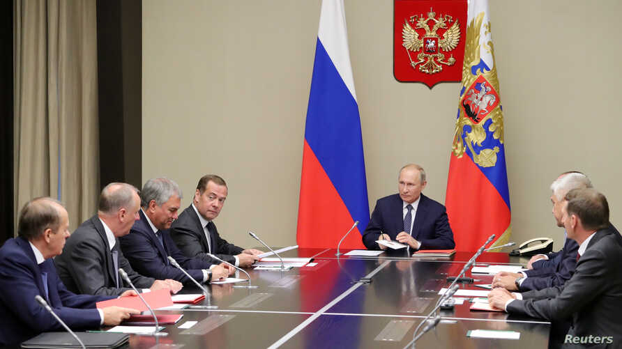 Russian President Vladimir Putin and Prime Minister Dmitry Medvedev attend a meeting with members of the Security Council at the Novo-Ogaryovo state residence outside Moscow, Aug. 5, 2019. (Sputnik/M. Klimentyev/Kremlin)