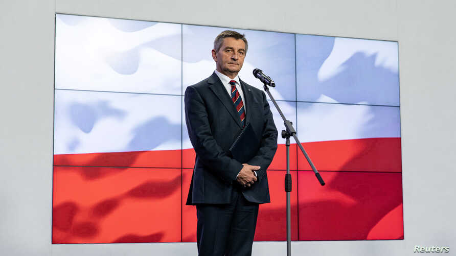 Poland's parliament speaker Marek Kuchcinski speaks during a news conference in Warsaw, Poland, Aug. 8, 2019.