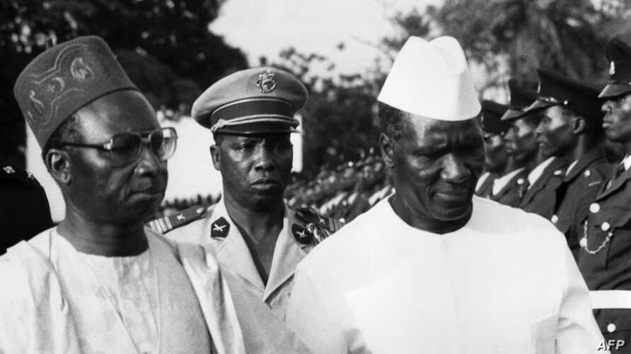 FILE - Ahmed Seku Toure (R), President of Guinea, the new independent state in South West Africa, is greeted in the 1960s in Banjul by Sir Dawda Jawara, President of Gambia.