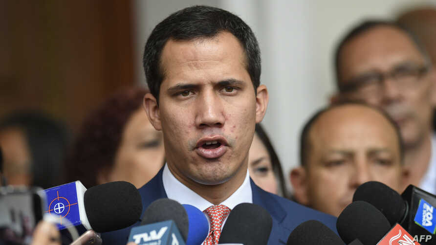 Venezuelan opposition leader and self-proclaimed acting president Juan Guaido speaks with journalists after taking part in a session at the National Assembly in Caracas, Aug. 13, 2019.