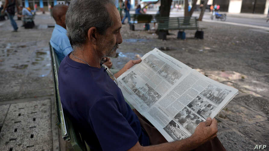 A man reads a Cuban newspaper in Havana, May 19, 2018.