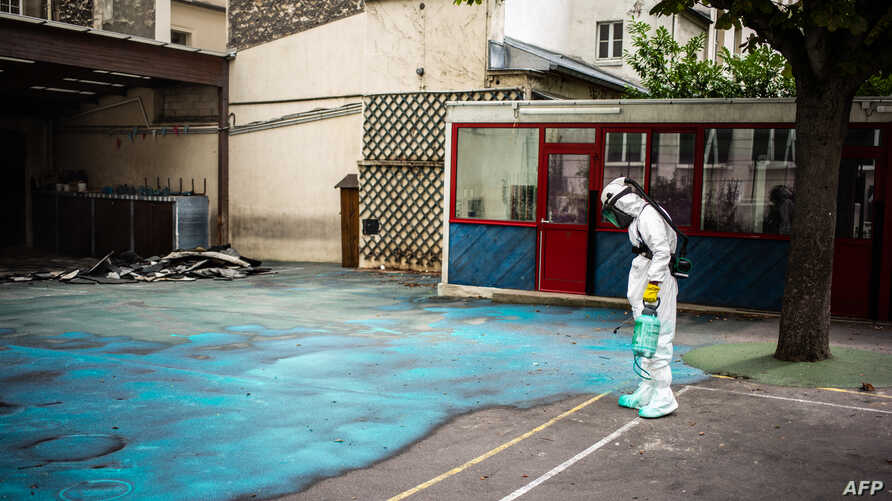 A worker sprays a gel on the ground to absorb lead during a decontamination operation at Saint Benoit school near Notre-Dame cathedral in Paris, France.
