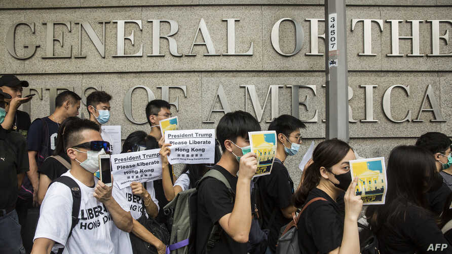 Protesters march past the U.S. Consulate to deliver a petition asking for support to oppose a proposed law that would allow extraditions to the Chinese mainland, in Hong Kong, June 26, 2019.