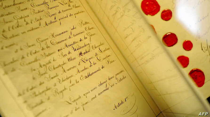 "FILE - The original document of the 1st Geneva Convention ""for the Amelioration of the Condition of the Wounded in Armies in the Field"" signed in 1864 is seen at the International Red Cross and Red Crescent Museum in Geneva, Switzerland."