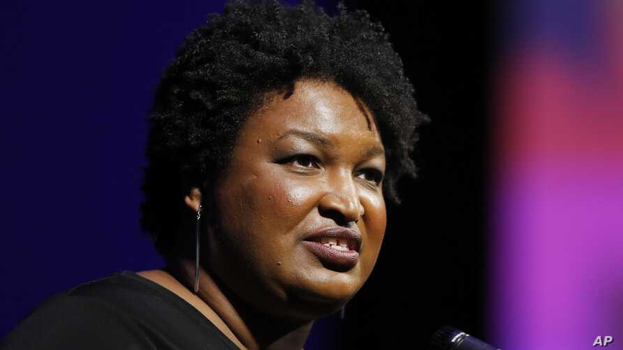 Former Georgia House Minority Leader Stacey Abrams addresses the 110th NAACP National Convention, July 22, 2019, in Detroit.
