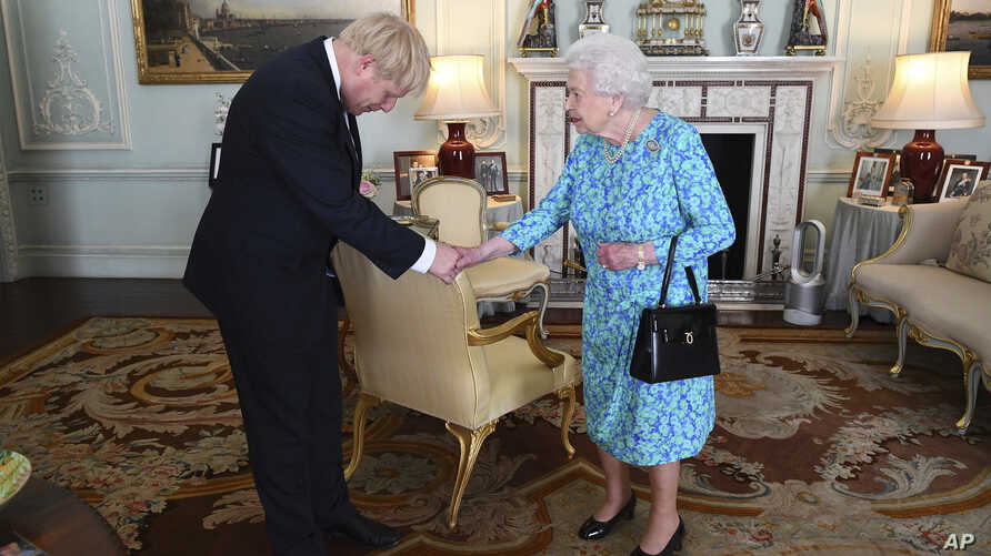 Britain's Queen Elizabeth II welcomes Boris Johnson, then newly-elected leader of the Conservative party, during an audience at Buckingham Palace, London, England, July 24, 2019.