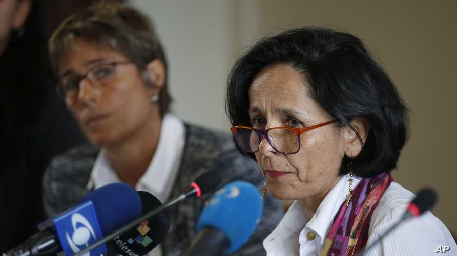 Luz Marina Monzon, left, director of the missing person's unit, speaks during a presentation on information on those disappeared during the nation's civil conflict, in Bogota, Colombia, Aug. 20, 2019.