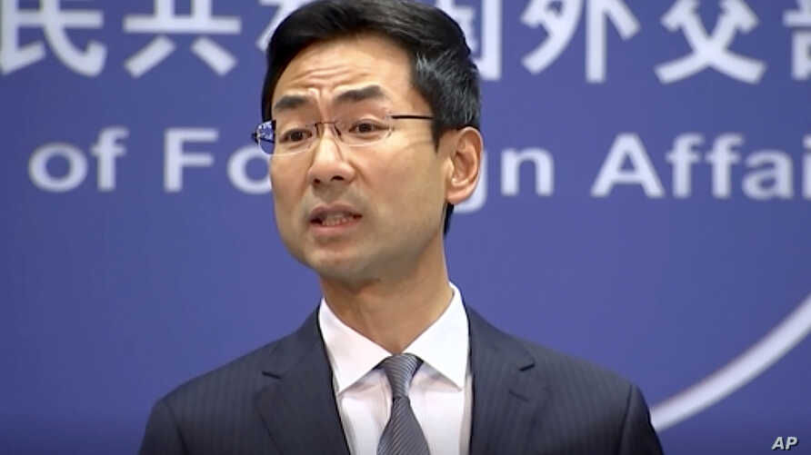 In a still image from video, Chinese Foreign Ministry spokesman Geng Shuang speaks during a media briefing in which he commented on investigations into Chinese-Australian writer Yang Hengjun in Beijing, July 17, 2019.