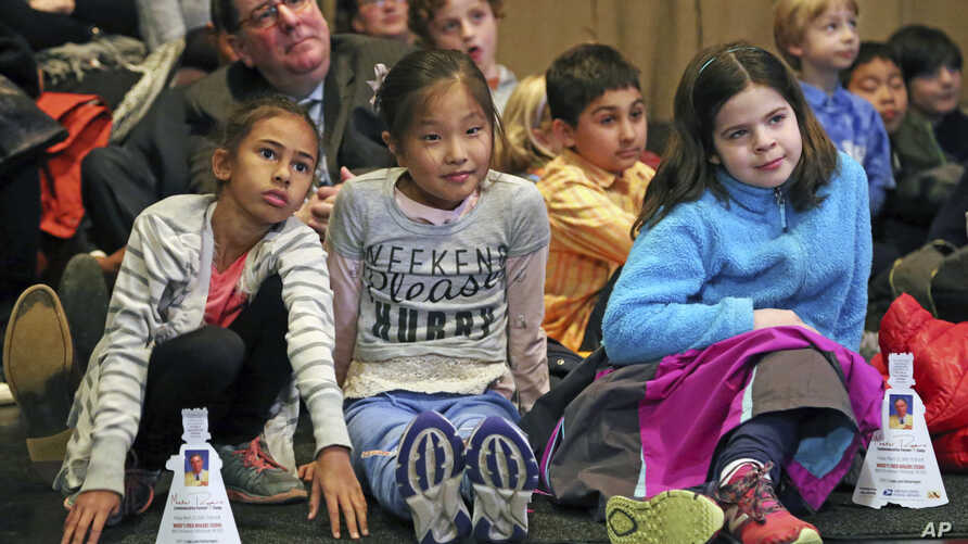 FILE -- Pittsburgh Mayor Bill Peduto, left rear, sits on the floor with a group of students from Oakland's Falk School during th