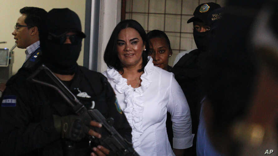 Former Honduran first lady Rosa Elena Bonilla de Lobo smiles arrives to court for her sentencing on corruption charges in Tegucigalpa, Honduras, Aug. 20, 2019.