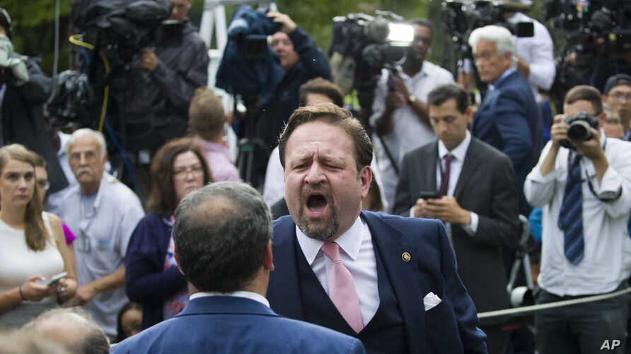 Conservative radio host Sebastian Gorka yells at Playboy reporter Brian Karem after President Donald Trump spoke about the 2020 census in the Rose Garden of the White House, in Washington, July 11, 2019.