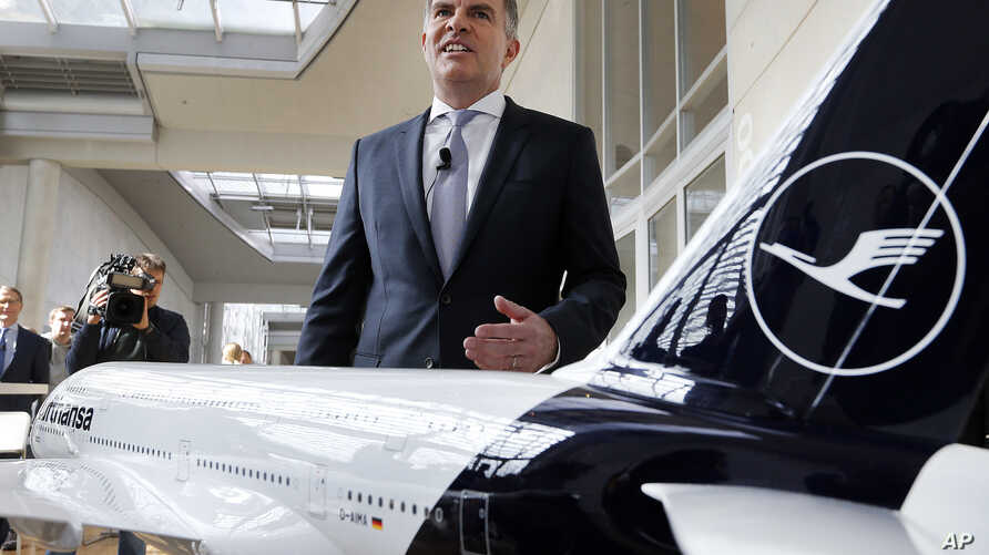 CEO of German Lufthansa airline Carsten Spohr stands next to a model of a Boeing 747 prior to a press conference in Frankfurt, Germany, March 15, 2018.