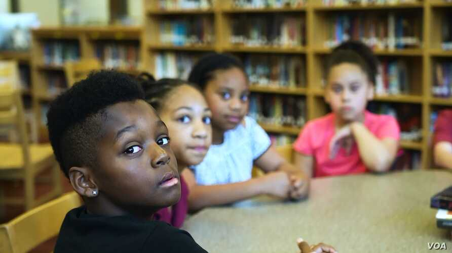 Students at George P. Phenix School in Hampton, Virginia, discuss slavery and race relations with the school principal.