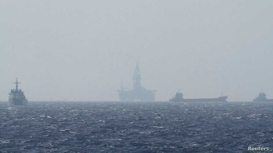 Ships and an oil rig, center, which China calls Haiyang Shiyou 981, and Vietnam refers to as Hai Duong 981, is seen in the South China Sea, off the shore of Vietnam, May 14, 2014.