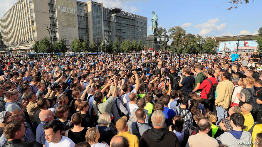 Activists attend a rally to demand authorities allow opposition candidates to run in an upcoming local election, and release protesters detained during recent demonstrations, in Moscow, Russia, Aug. 31, 2019.