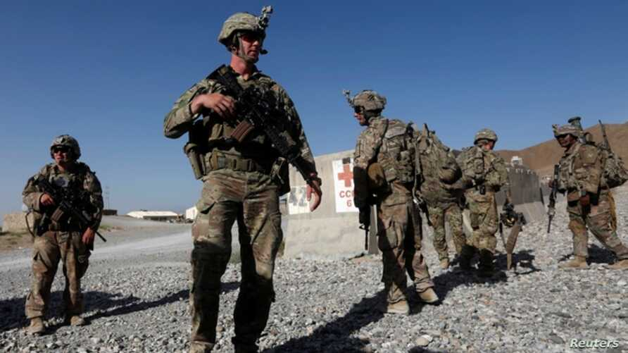 FILE - U.S. troops wait for their helicopter flight at an Afghan National Army (ANA) base in Logar province, Afghanistan, Aug. 7, 2018.