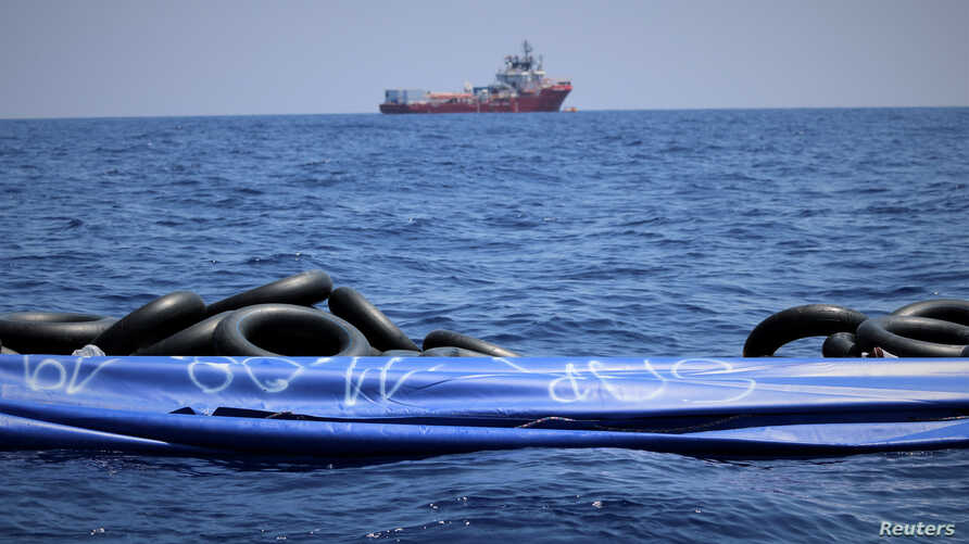 The migrant rescue ship Ocean Viking, run by two French charities, floats in the distance, as it waits in international waters between Malta and southern Italy for access to a port in this handout picture taken between Aug. 9 and 12, 2019.