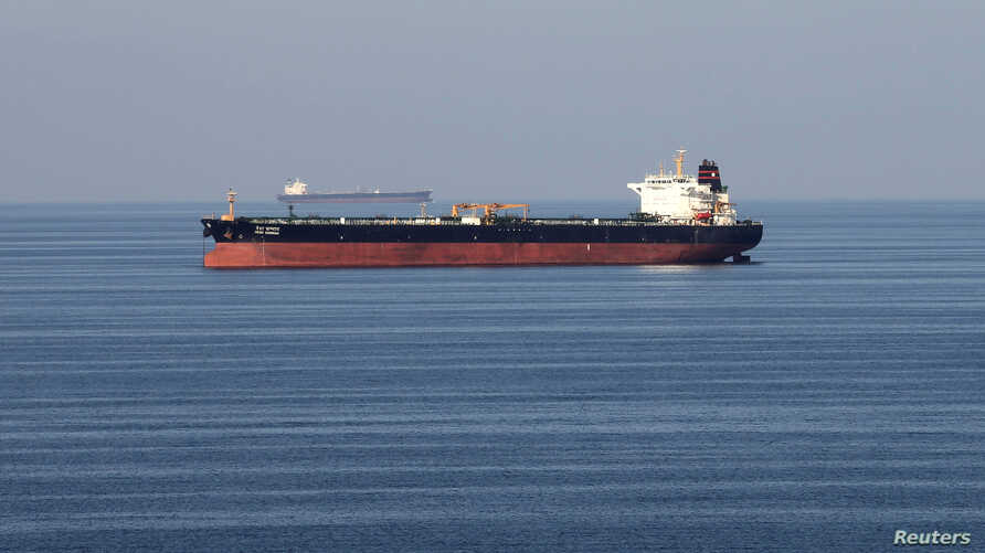FILE - Oil tankers pass through the Strait of Hormuz, Dec. 21, 2018.