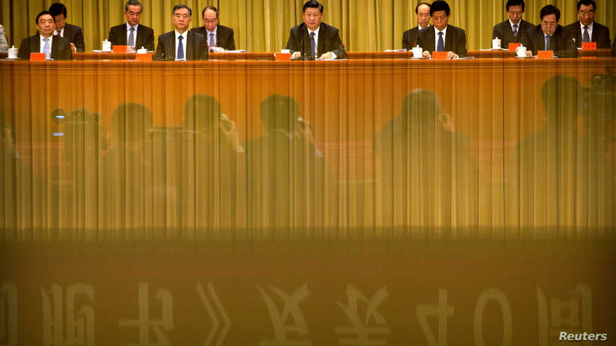 "FILE - Chinese President Xi Jinping (C) speaks during an event to commemorate the 40th anniversary of the ""Message to Compatriots in Taiwan"" at the Great Hall of the People in Beijing, Jan. 2, 2019."