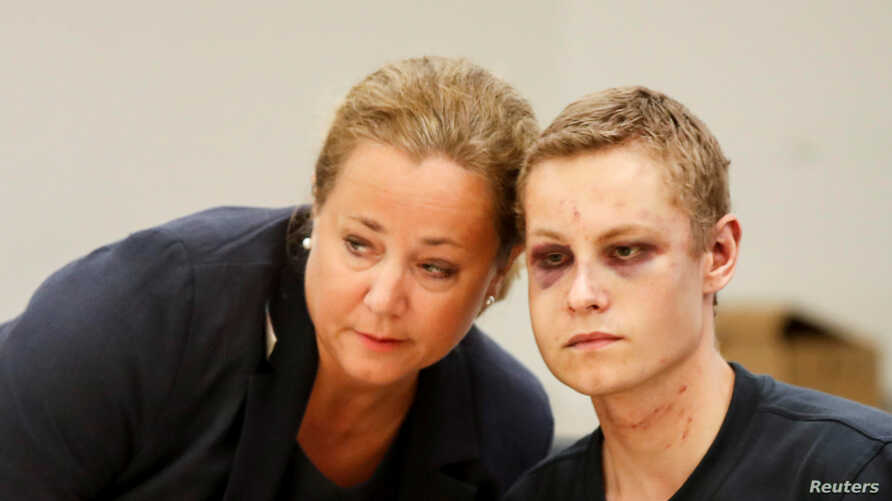 Philip Manshaus, with black eyes and wounds on his face and neck, appears with his lawyer Unni Fries in court in Oslo, Norway. Manshaus, 21, is suspected of an armed attack at Al-Noor Islamic Centre Mosque and killing his stepsister.