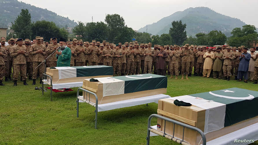 Army soldiers and civilians attend the funeral of three soldiers who, according to Pakistan Army, were killed in a cross-border exchange of fire on the Line of Control, at army stadium in Muzaffarabad, Pakistan-administrated Kashmir, Aug. 16, 2019.