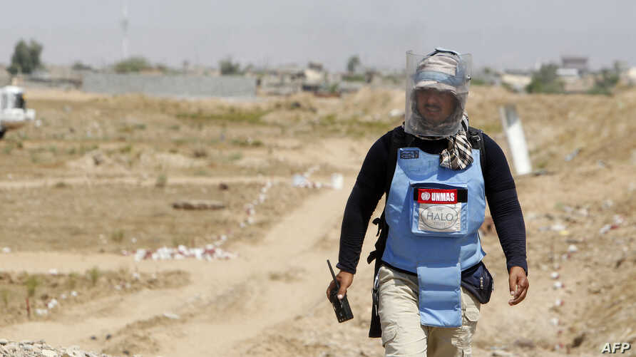 An Iraqi mine clearer working for Halo Trust, a non-profit organization specialized in mine removal, is pictured in an agricultural and industrial field near the Iraqi town of Baiji, Aug. 25, 2019.