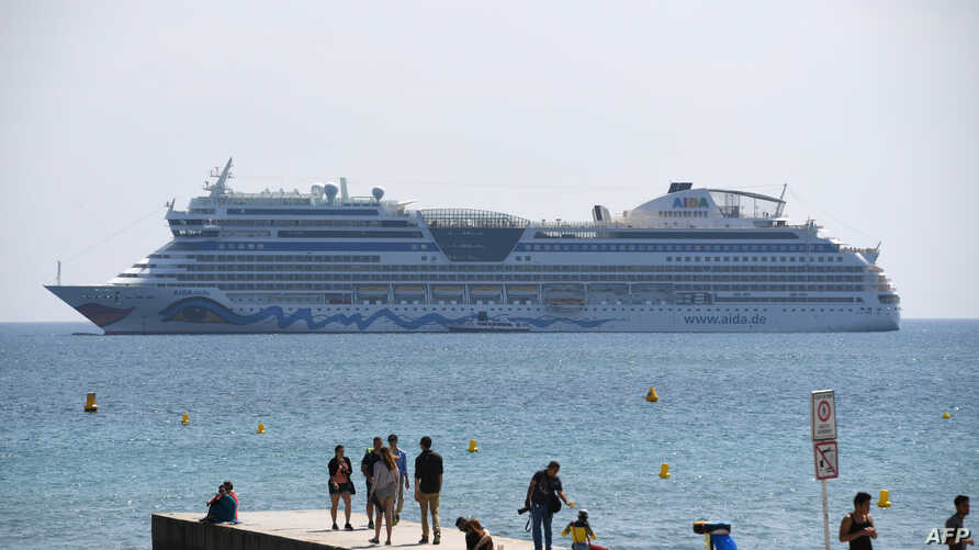 FILE - A cruise ship is pictured in the bay of the southeastern French city of Cannes, May 10, 2016.