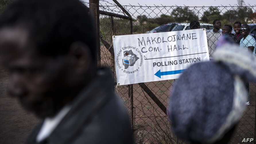 FILE - Residents queue to cast their ballots at a polling station in Serewe, Botswana, Oct. 24, 2014.