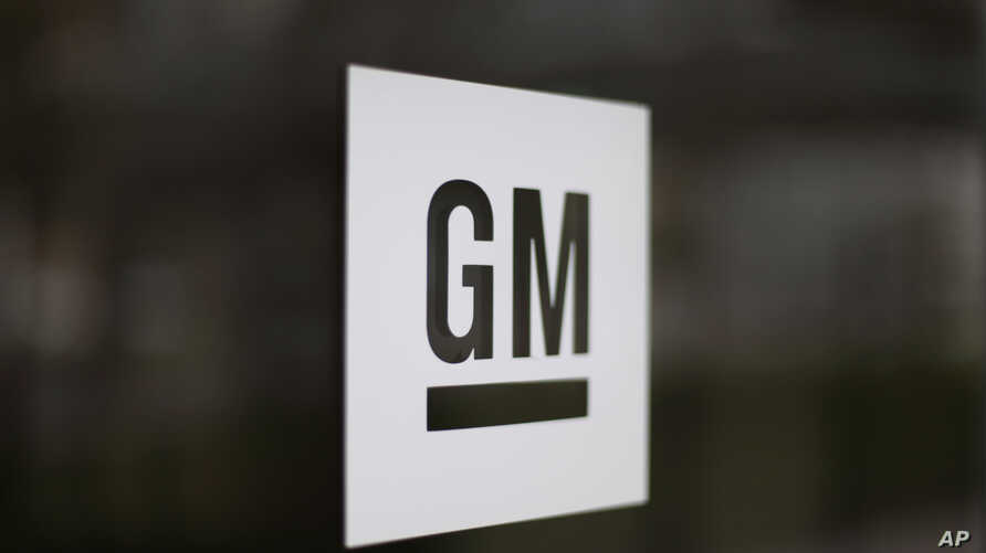 FILE - The General Motors logo at the company's world headquarters in Detroit.