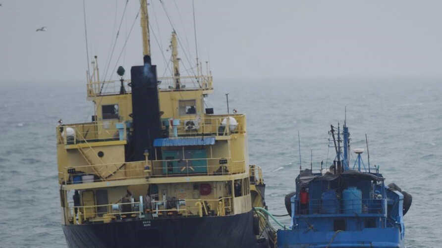 "FILE - This photo released by Japan's Ministry of Defense shows what it says is the North Korean-flagged tanker Yu Jong 2, left, and Min Ning De You 078 lying alongside in the East China Sea, Feb. 16, 2018. China says it is ""highly concerned"" about a reported ship-to-ship transfer that could violate U.N. sanctions on North Korea."