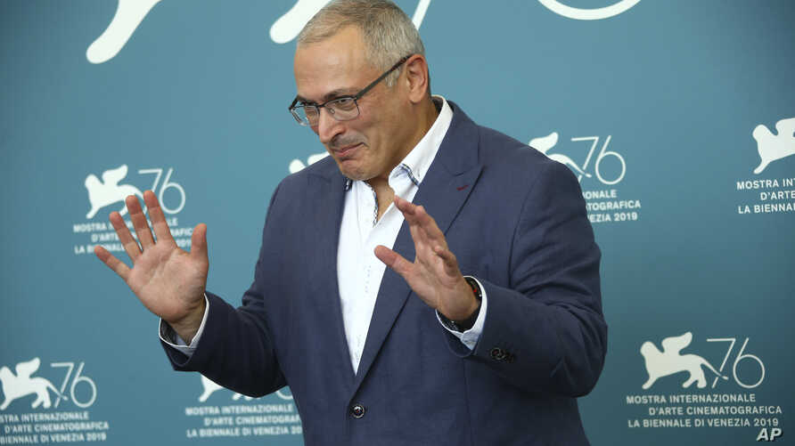 Russian oligarch Mikhail Khodorkovsky poses for photographers at the photo call for the film 'Citizen K' at the 76th edition of the Venice Film Festival in Venice, Italy, Aug. 31, 2019.