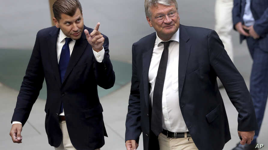 Christian Lüth, spokesman of the Alternative for Germany (AfD) party, left, and Joerg Meuthen, co-chairman of the Alternative for Germany (AfD) party, right, arrive for a press conference in Berlin, Germany, Sept. 2, 2019.