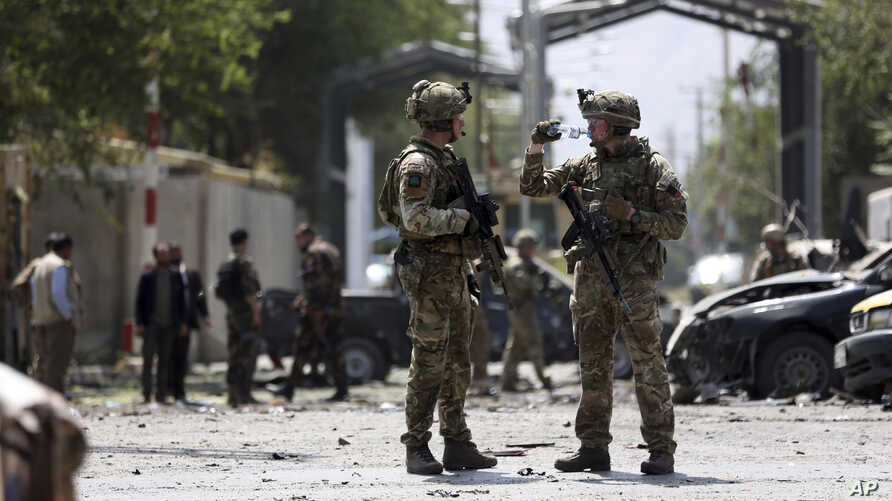 Resolute Support (RS) forces arrive at the site of car bomb explosion in Kabul, Afghanistan, Thursday, Sept. 5, 2019.