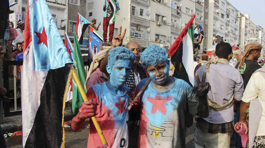 Supporters of southern separatists with their faces painted with the colors of the South Yemen during a rally to show support to the UAE amid a standoff with the  government, in Aden, Yemen, Sept. 5, 2019.