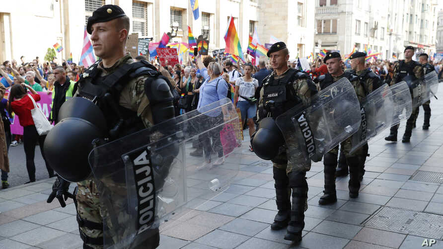 Policemen guard the country's first ever LGBT pride parade in downtown Sarajevo, Bosnia-Herzegovina, Sept. 8, 2019.
