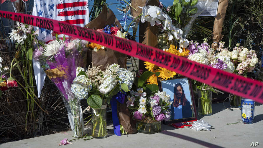 Red crime scene tape is placed by a memorial for the victims of the Conception dive boat fire on the Santa Barbara Harbor, as authorities issue a search warrant for the Truth Aquatics' offices on the Santa Barbara Harbor in California, Sept. 8, 2019.
