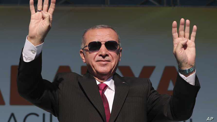 Turkey's President Recep Tayyip Erdogan salutes supporters during a rally in Malatya, Turkey, Sept. 8, 2019.